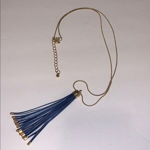 Gold tone long chain tassel necklace